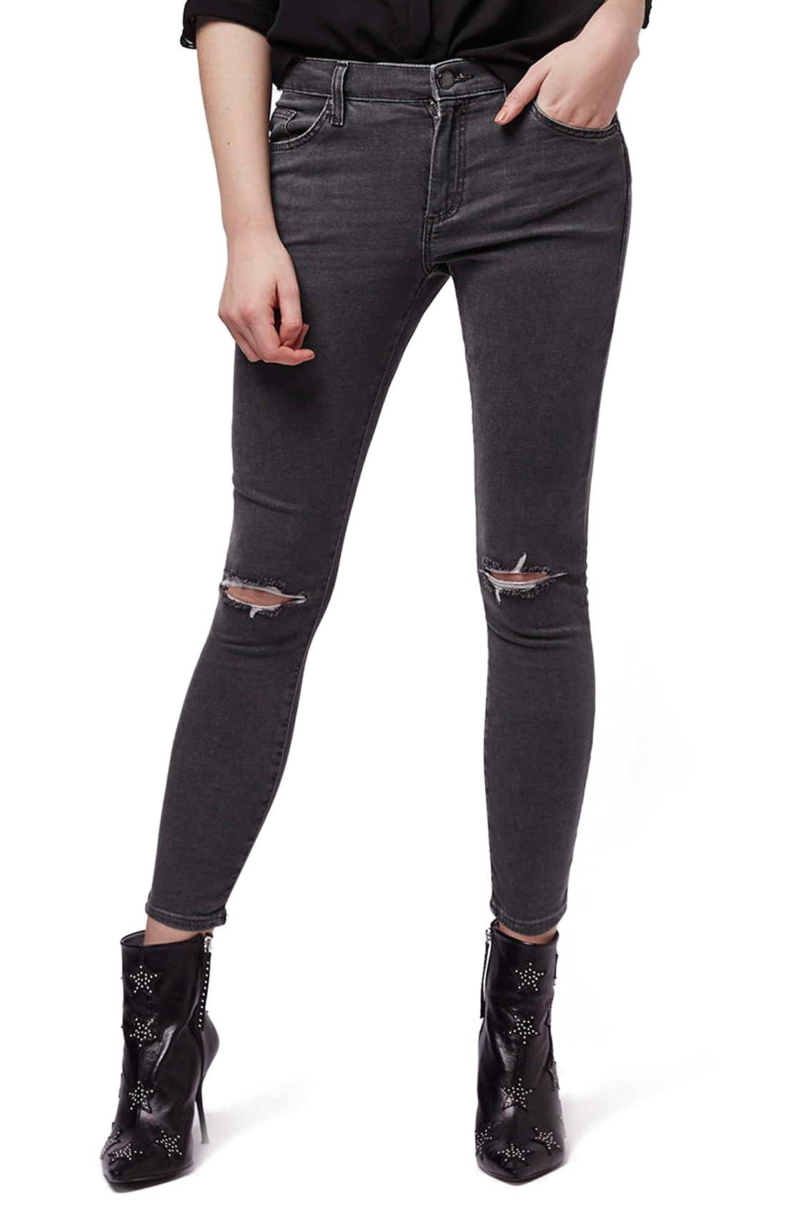 Alternate Image 1 Selected - Topshop 'Leigh' Ripped Skinny Jeans (Petite)
