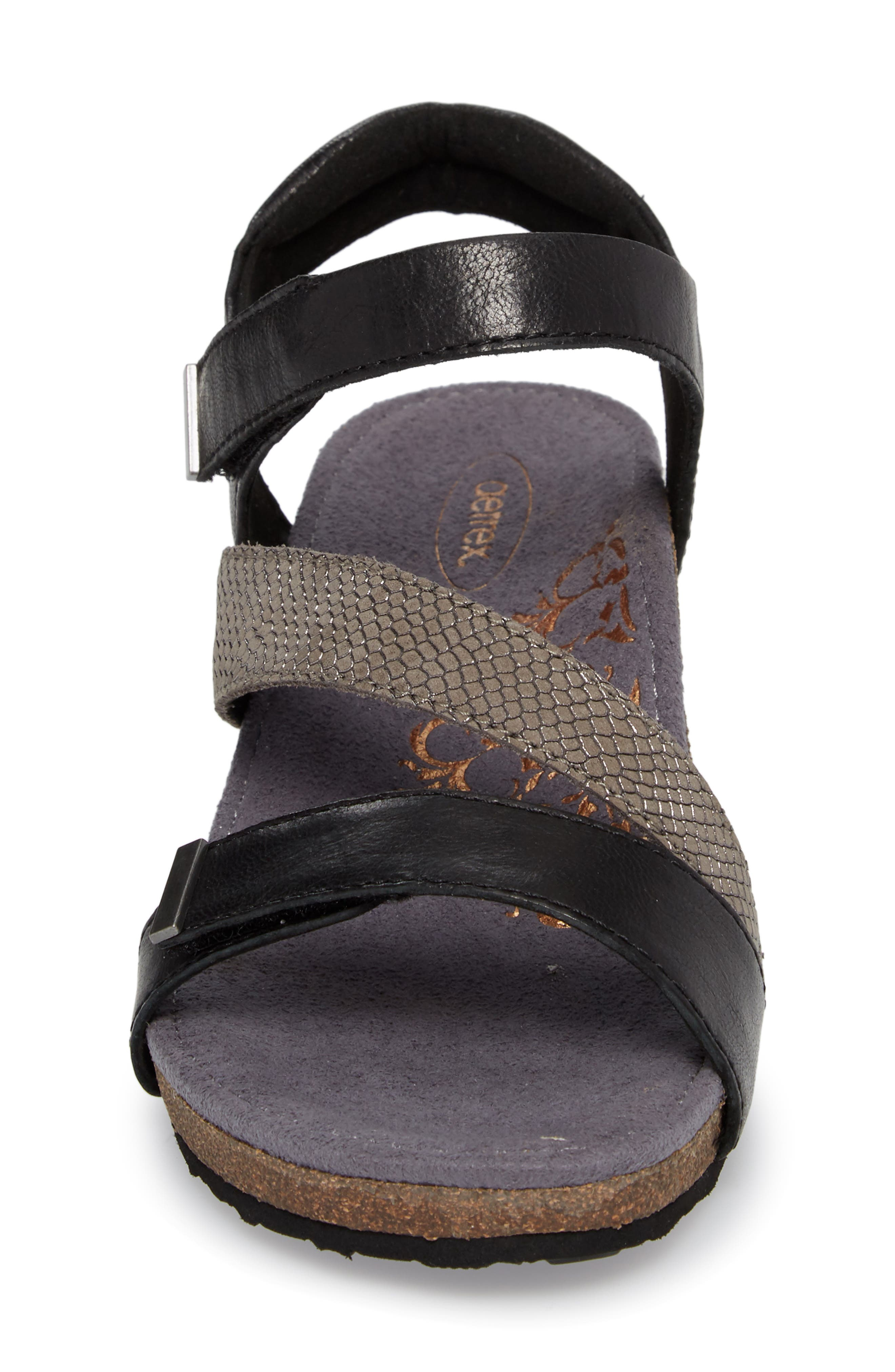 Brynn Asymmetrical Wedge Sandal,                             Alternate thumbnail 4, color,                             Black Leather