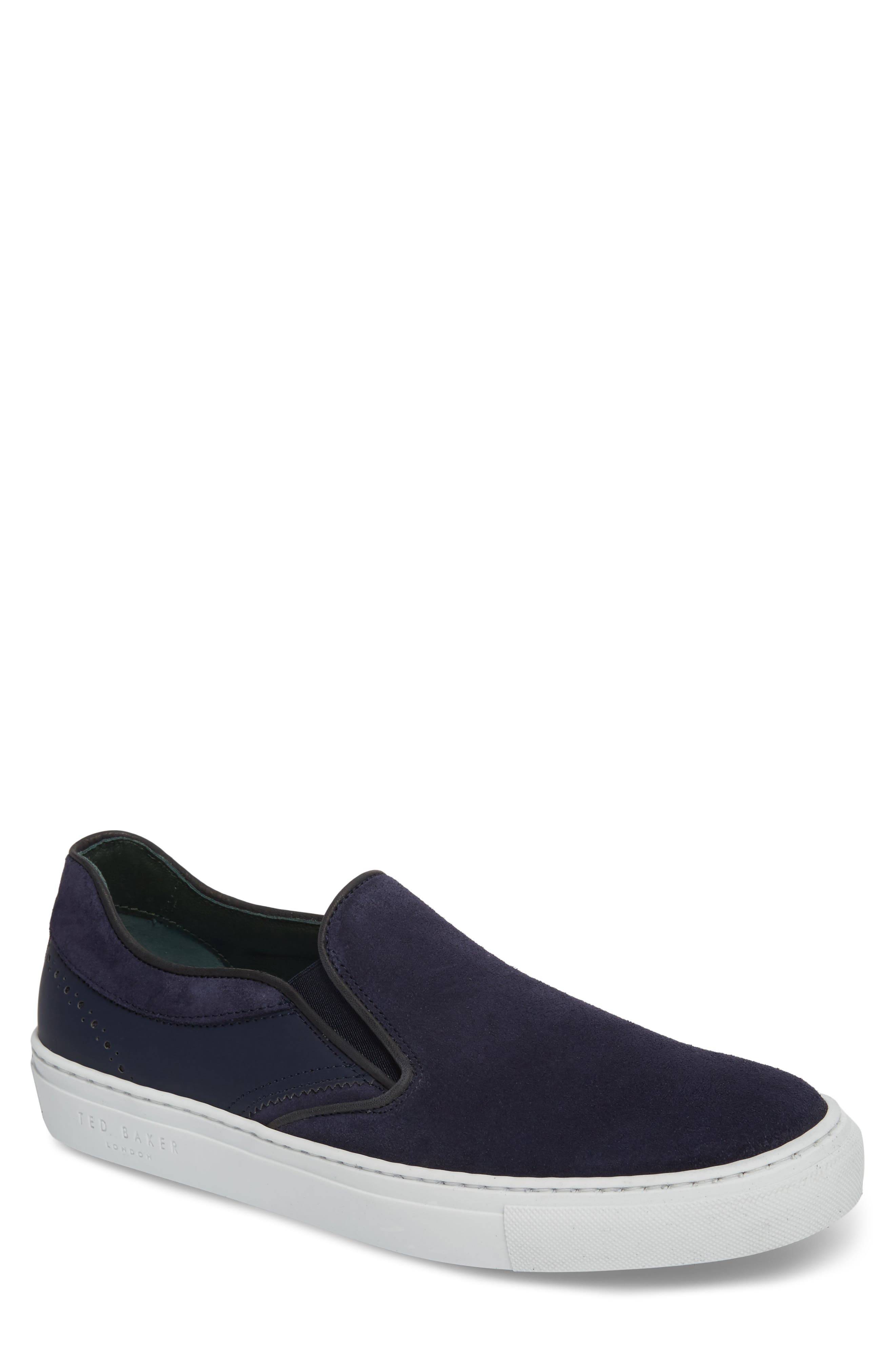 Reaine Brogued Slip-On Sneaker,                             Main thumbnail 1, color,                             Dark Blue Leather