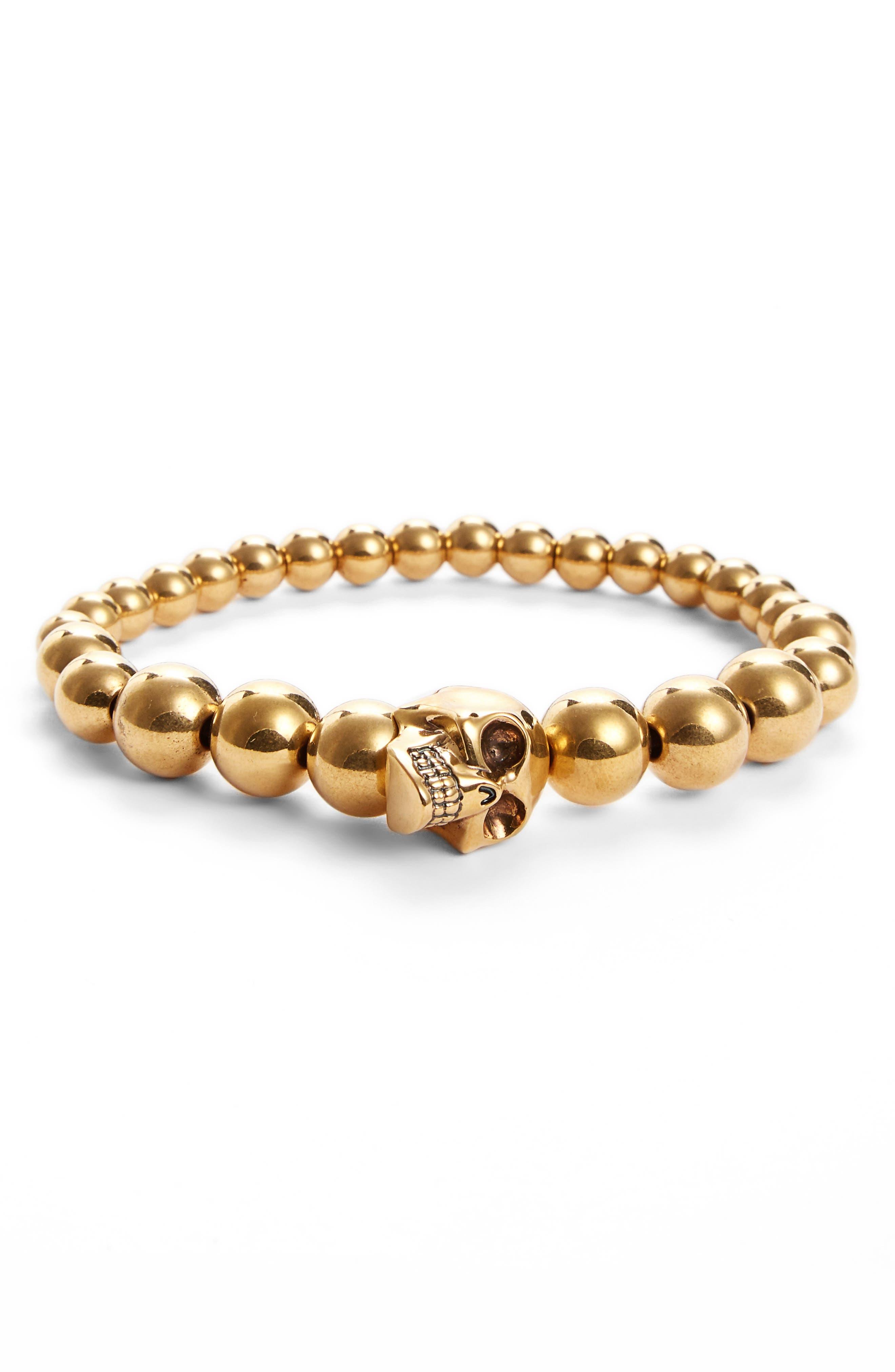 Alexandar McQueen Skull Ball Bracelet,                             Main thumbnail 1, color,                             Gold