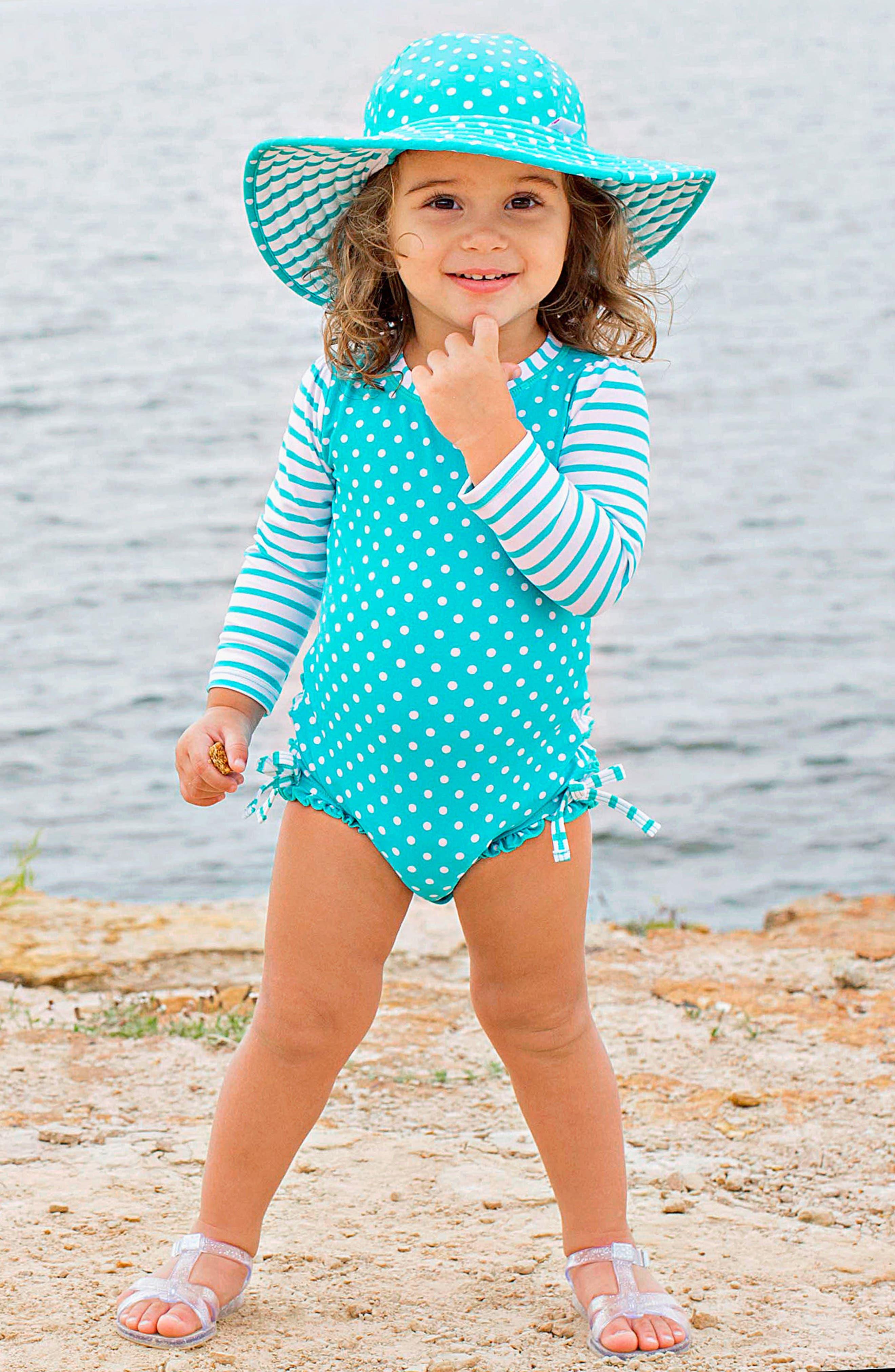 Alternate Image 3  - RuffleButts One-Piece Rashguard Swimsuit & Hat Set (Baby Girls)