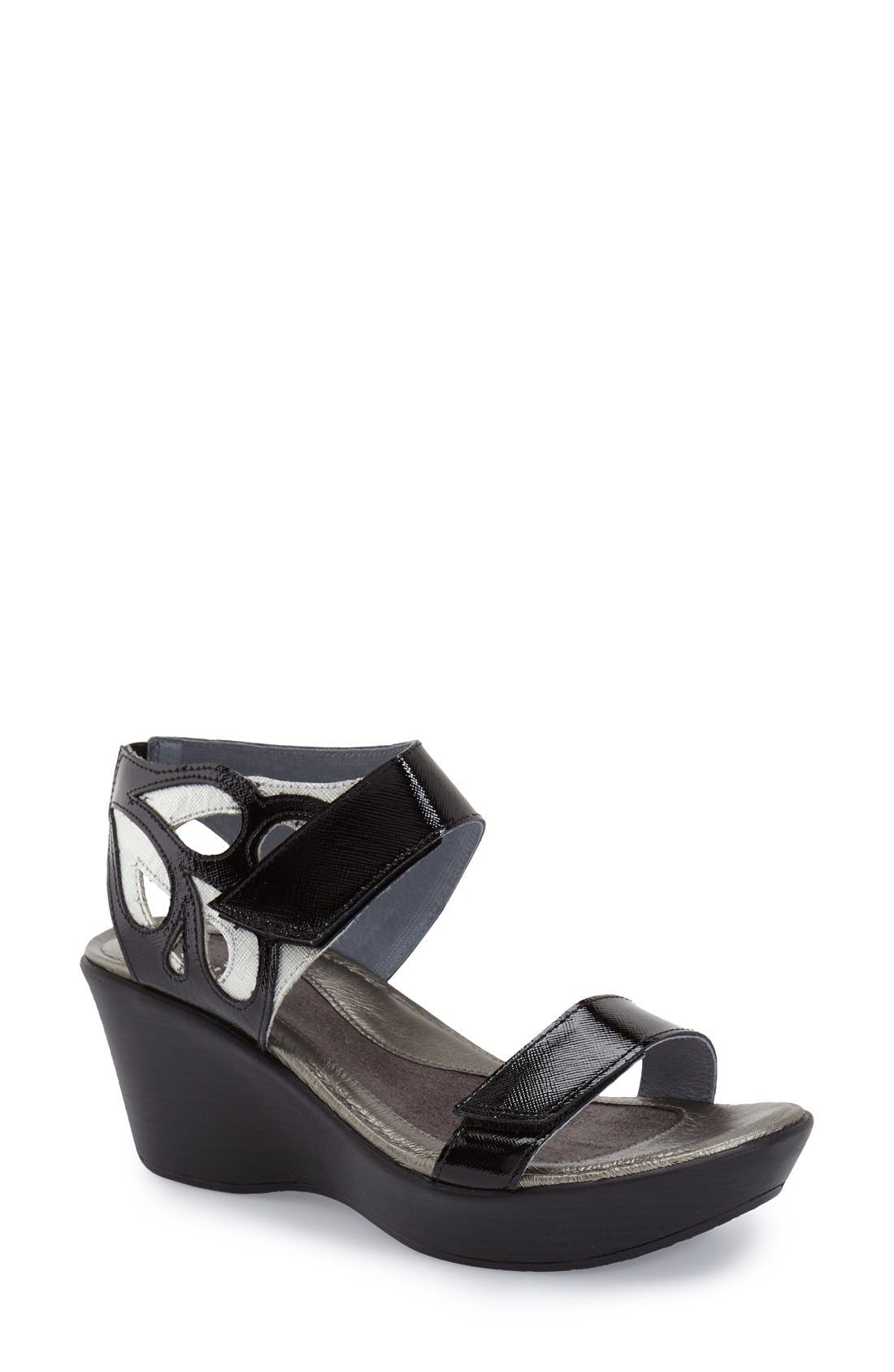 'Intrigue' Platform Wedge,                             Main thumbnail 1, color,                             Black Luster Leather