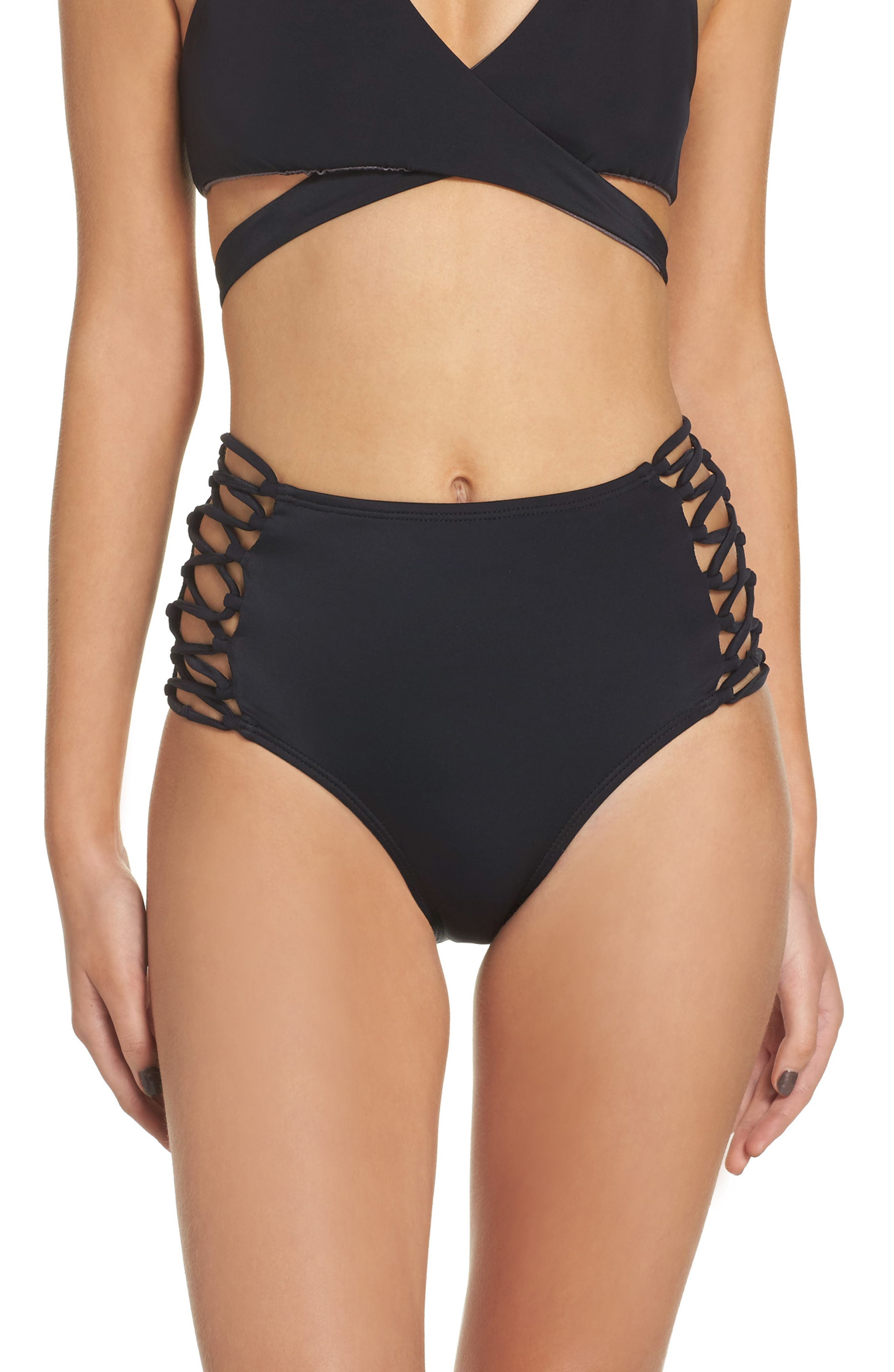 These high-waisted black bottoms have cute side details, but the top's keyhole neckline is the main reason for this suit's sex appeal. Advertisement - Continue Reading Below.