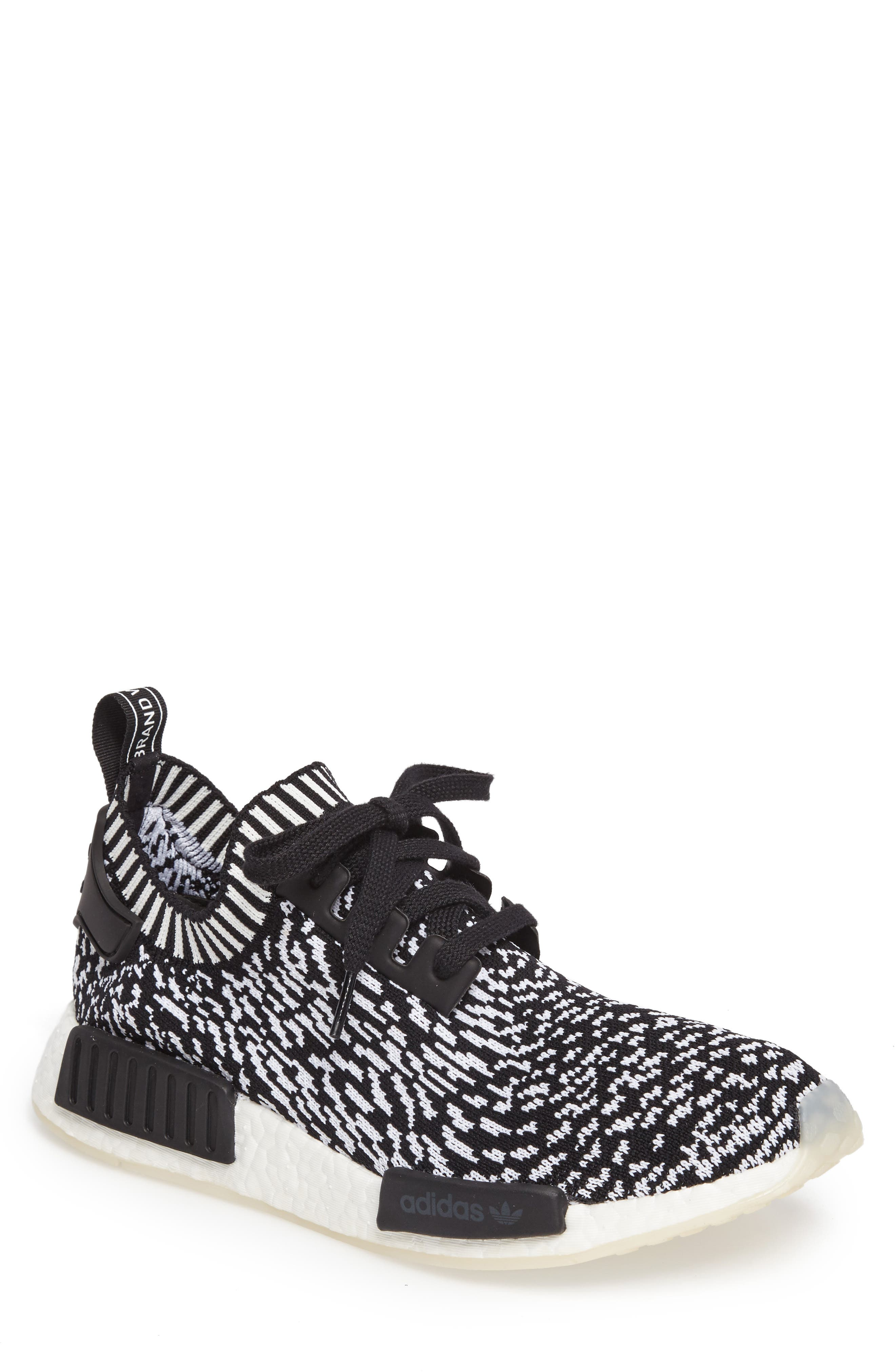 NMD R1 Primeknit Sneaker,                             Main thumbnail 1, color,                             Core Black/ Core Black/ White