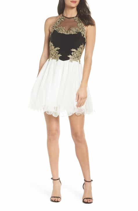 cbc934f4ce755 Blondie Nites Appliqué Bodice Fit   Flare Halter Dress
