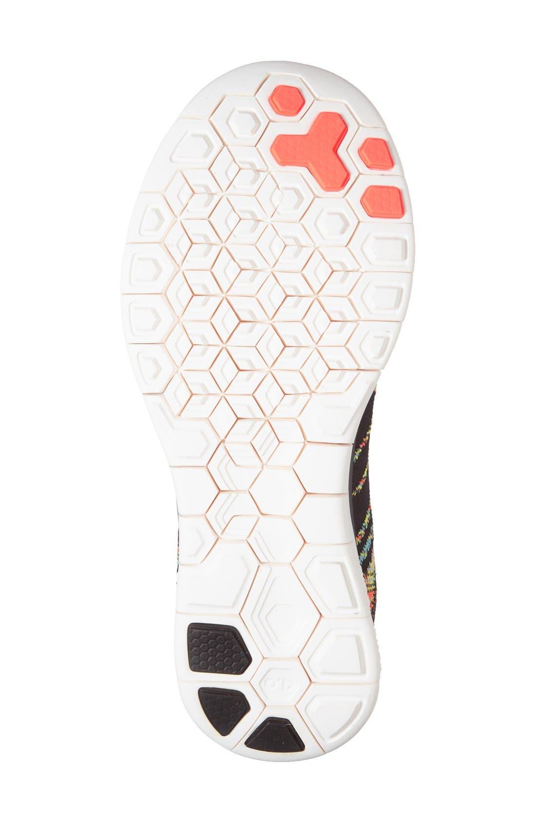 'Free 4.0 Flyknit' Running Shoe,                             Alternate thumbnail 4, color,                             Black/ Orange/ Blue