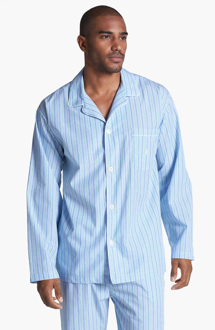The Pajamas Poly Cotton, model , are men's pajamas designed for use by men with physical disabilities. These pajamas feature a long- sleeved, a button front top and elastic-waist, full-length pants.