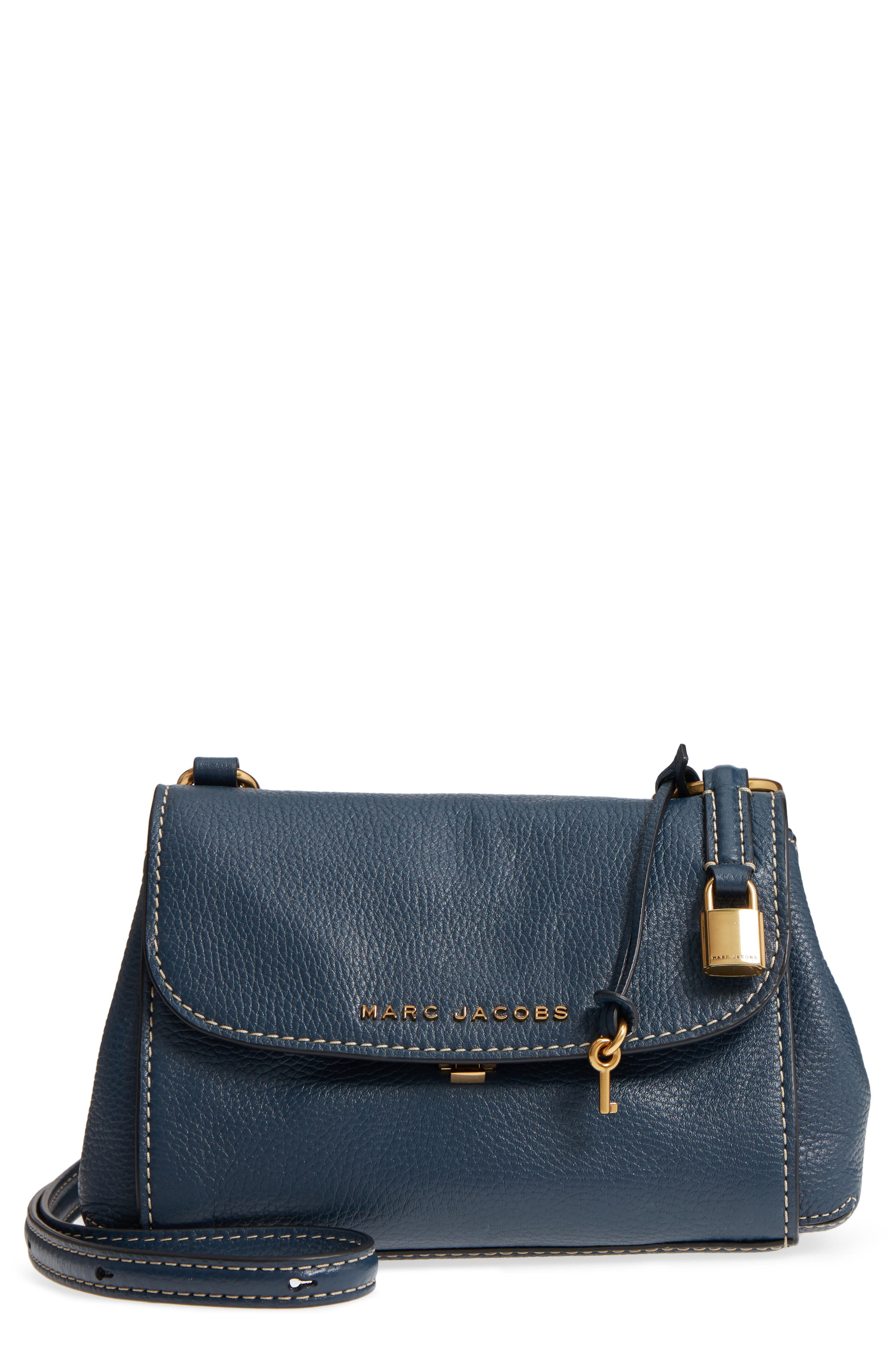 e91e7df87502f Chunky ring hardware secures the shoulder strap of a structured pebbled- leather flap bag outlined in bold topstitching. A convenient back slip  pocket makes ...