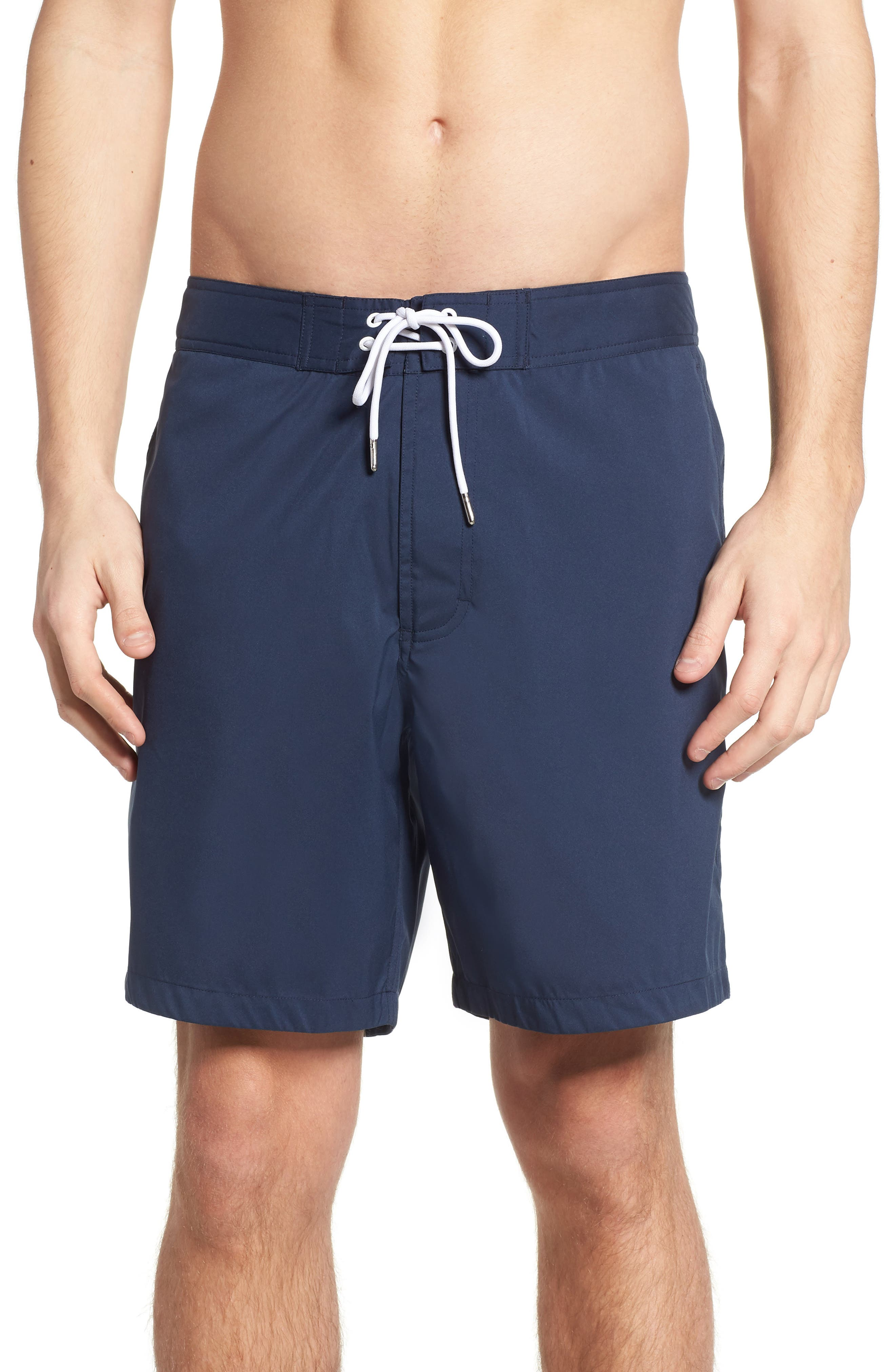 Solid 7-Inch Swim Trunks,                             Main thumbnail 1, color,                             Indio