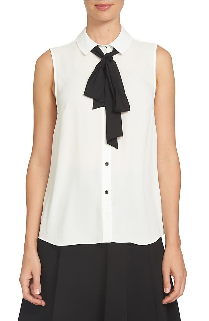 Bow Blouse: Versatile button-front top with removable neck tie is crafted of silky, smooth polyester. Features feminine shirring at shoulders. Features feminine shirring at shoulders. Machine wash/5(35).
