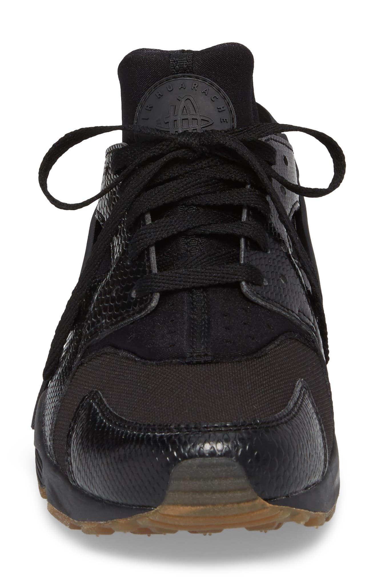 'Air Huarache' Sneaker,                             Alternate thumbnail 4, color,                             Black/ Elemental Gold/ Brown