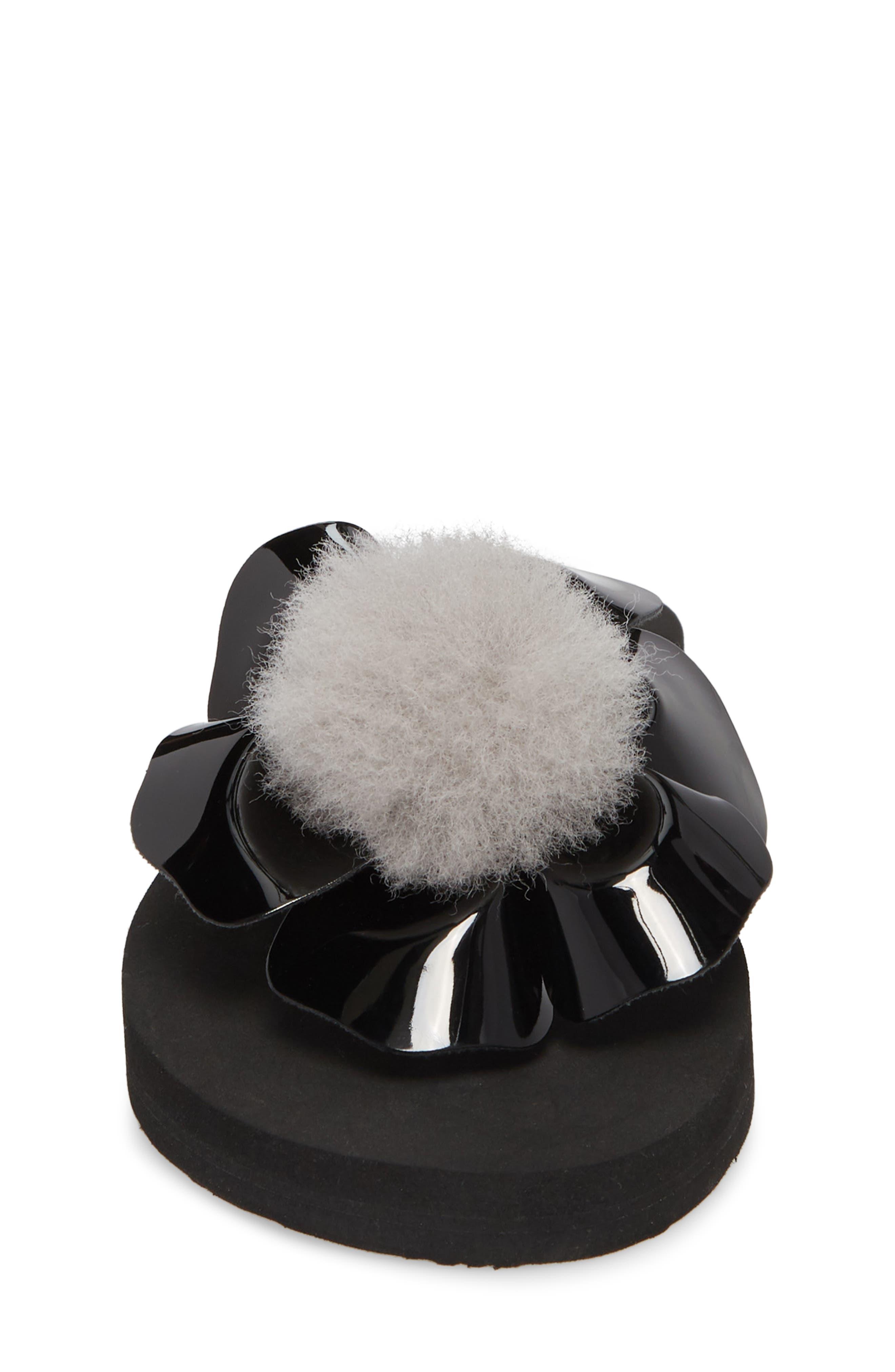 Poppy Genuine Shearling Flip Flop,                             Alternate thumbnail 4, color,                             Black