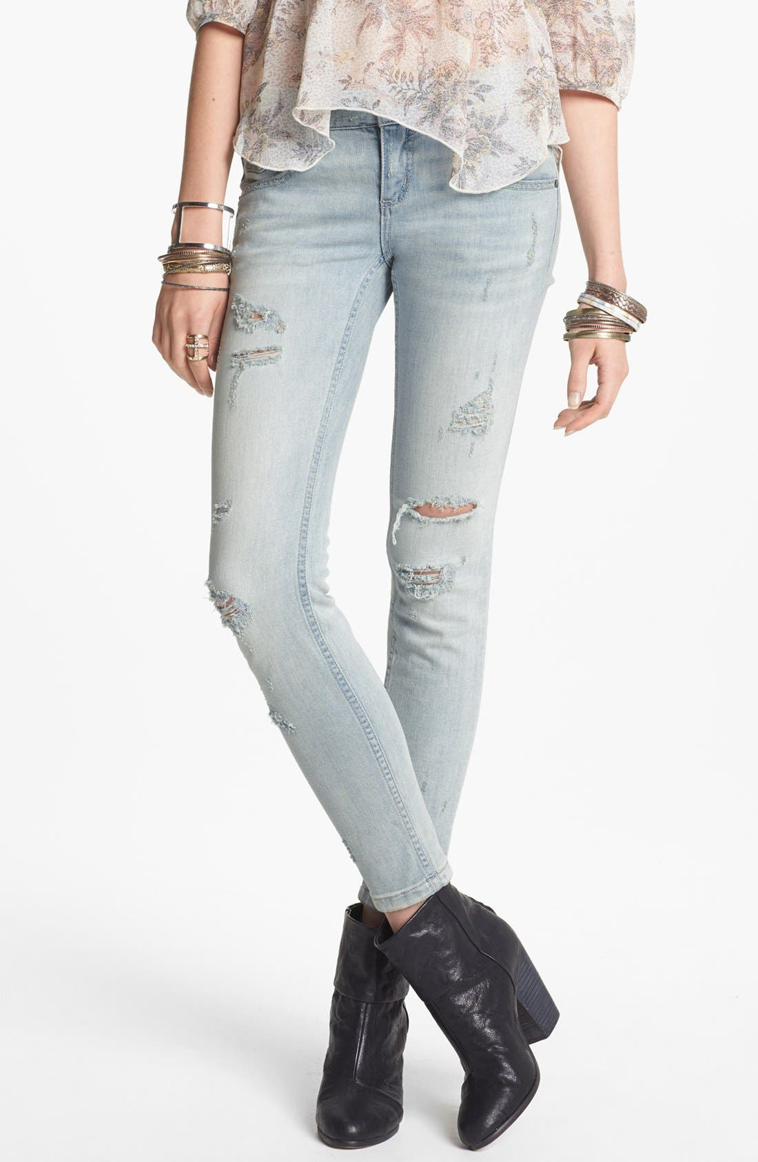 Alternate Image 1 Selected - Free People Destroyed Stretch Skinny Jeans (Light Wash)