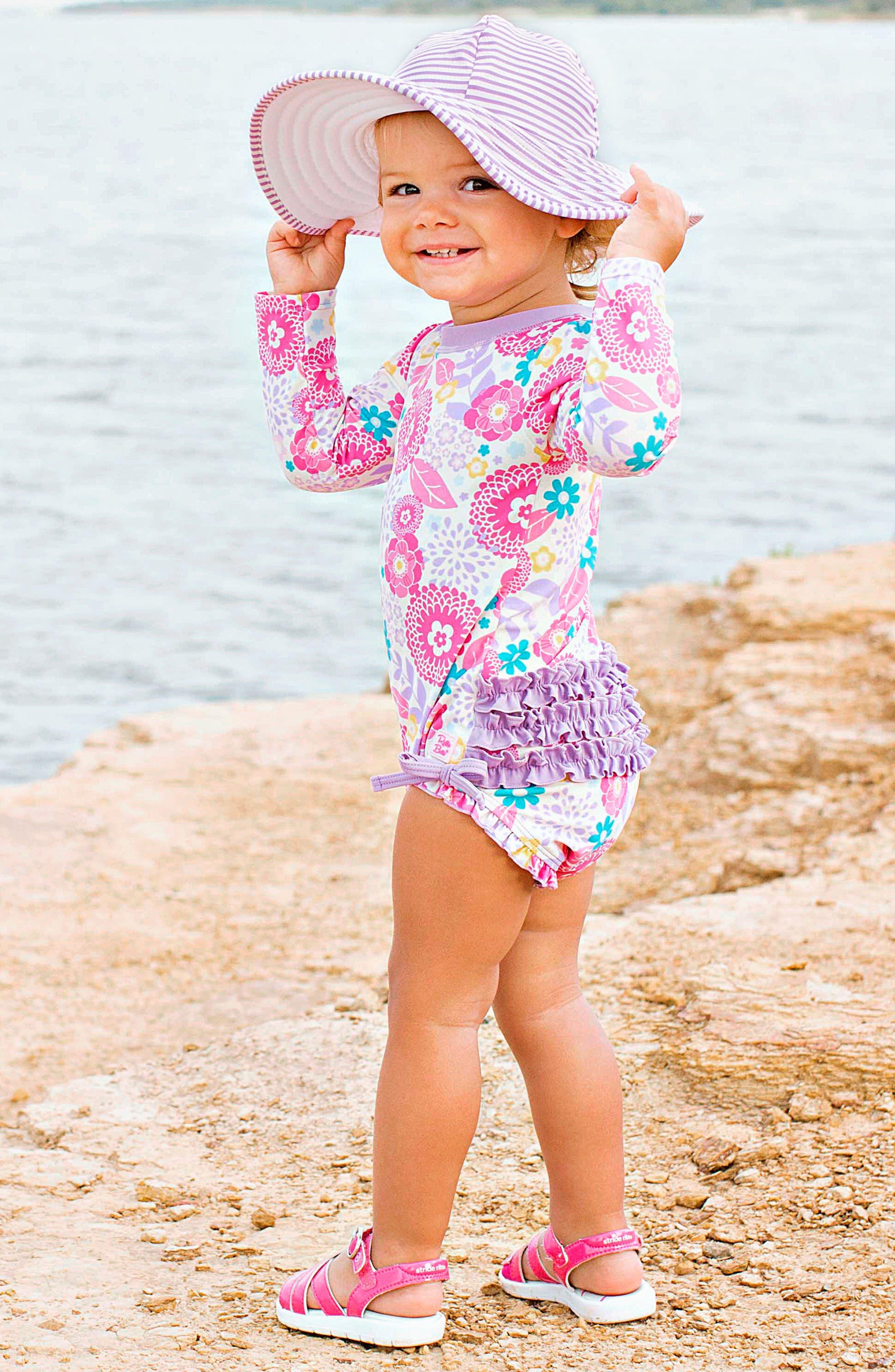 Alternate Image 3  - RuffleButts Blooming Buttercups One-Piece Rashguard Swimsuit & Hat Set (Baby Girls)