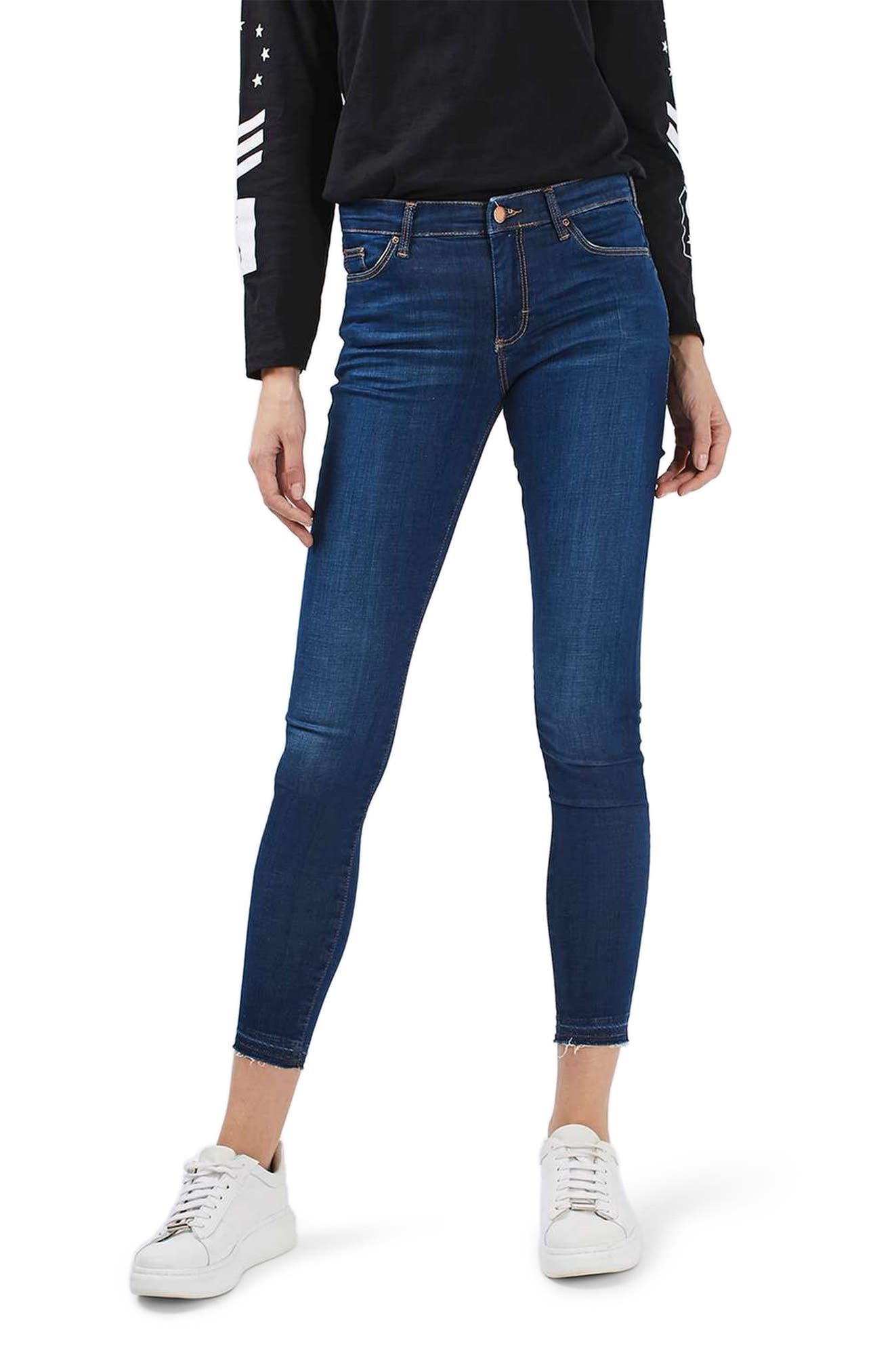 Leigh Released Hem Skinny Jeans,                             Main thumbnail 1, color,                             Indigo