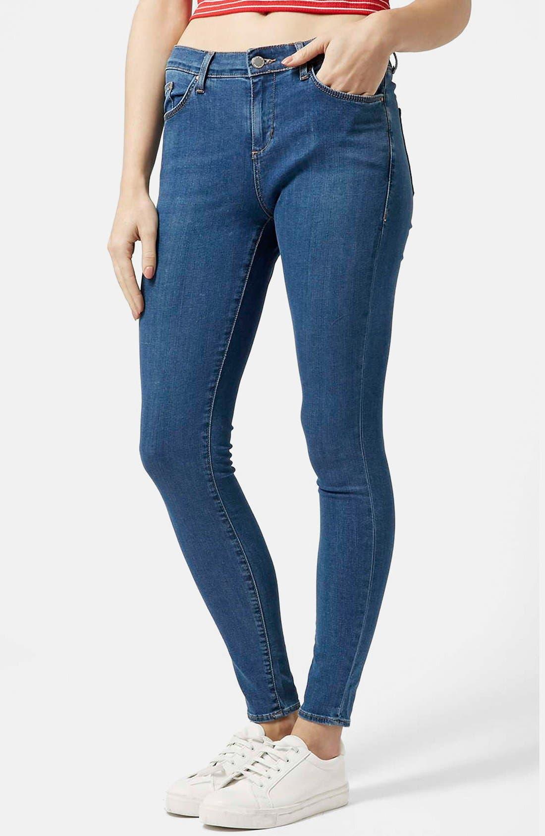 Main Image - Topshop Moto 'Leigh' Skinny Jeans (Mid Denim) (Regular & Short)
