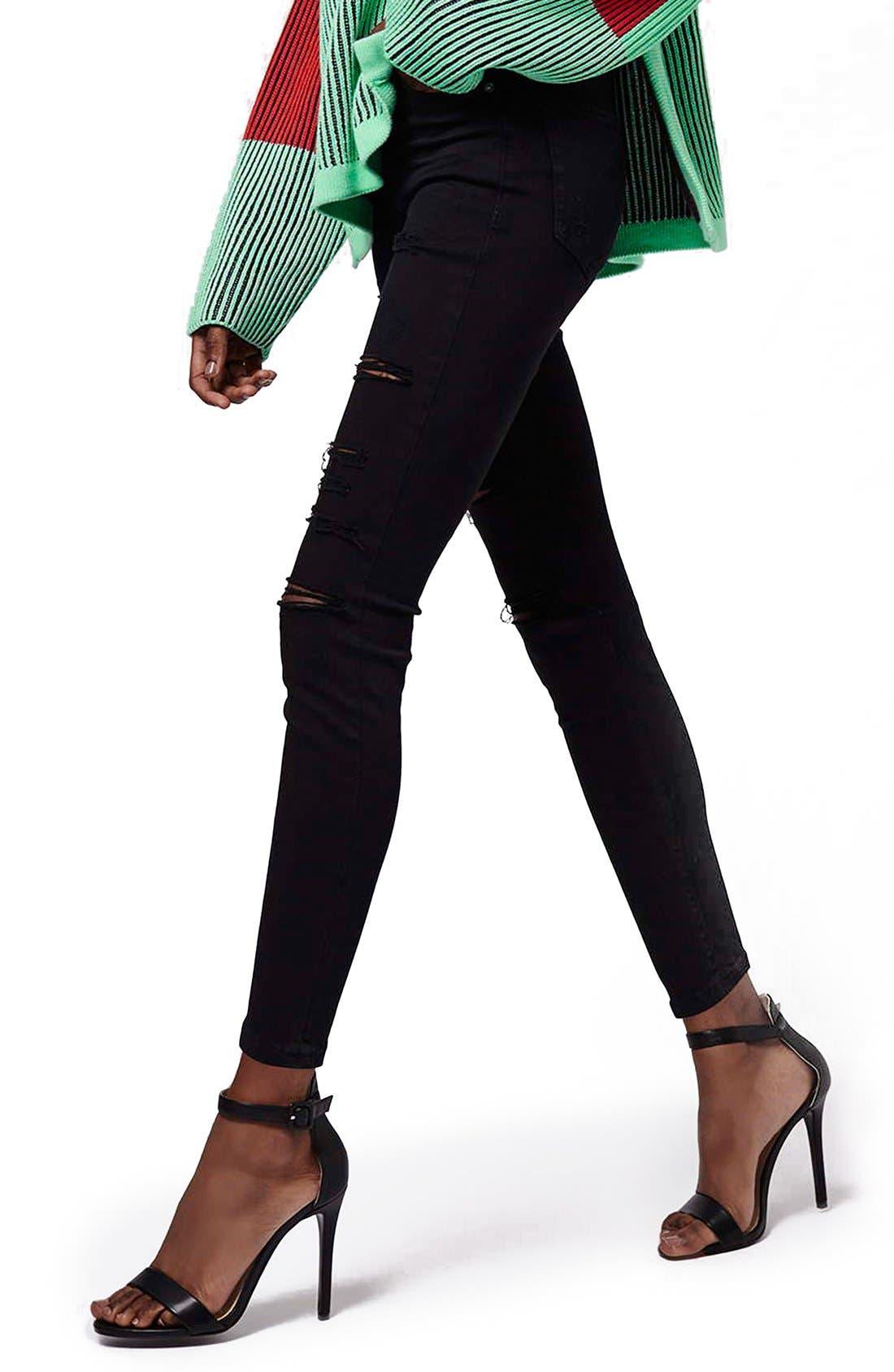 Alternate Image 1 Selected - Topshop Moto 'Jamie' Ripped Skinny Jeans (Black) (Petite)