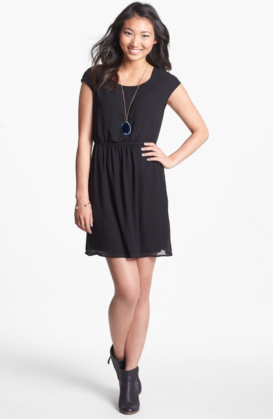 Main Image - dee elle Twist Back Cutout Skater Dress (Juniors)