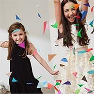 Two girls wearing dresses.
