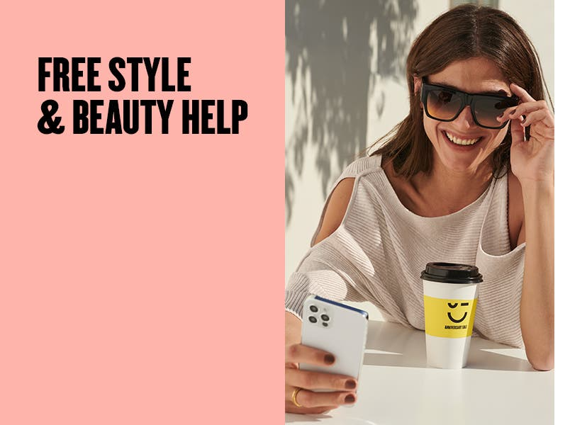 Free style and beauty help; woman looking at her phone with a coffee from Nordstrom.