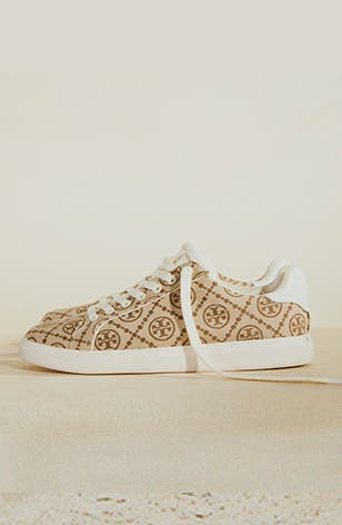A sneaker from the Tory Burch T Monogram collection.