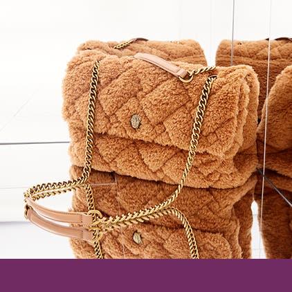 Luxury gifts for her. A fuzzy designer handbag.