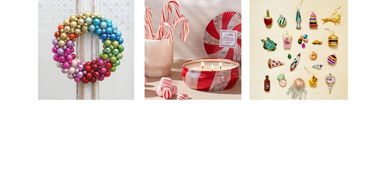A wreath made of glass balls. A jar of candy canes, candies and a peppermint tin candle. An assortment of colorful glass tree ornaments.