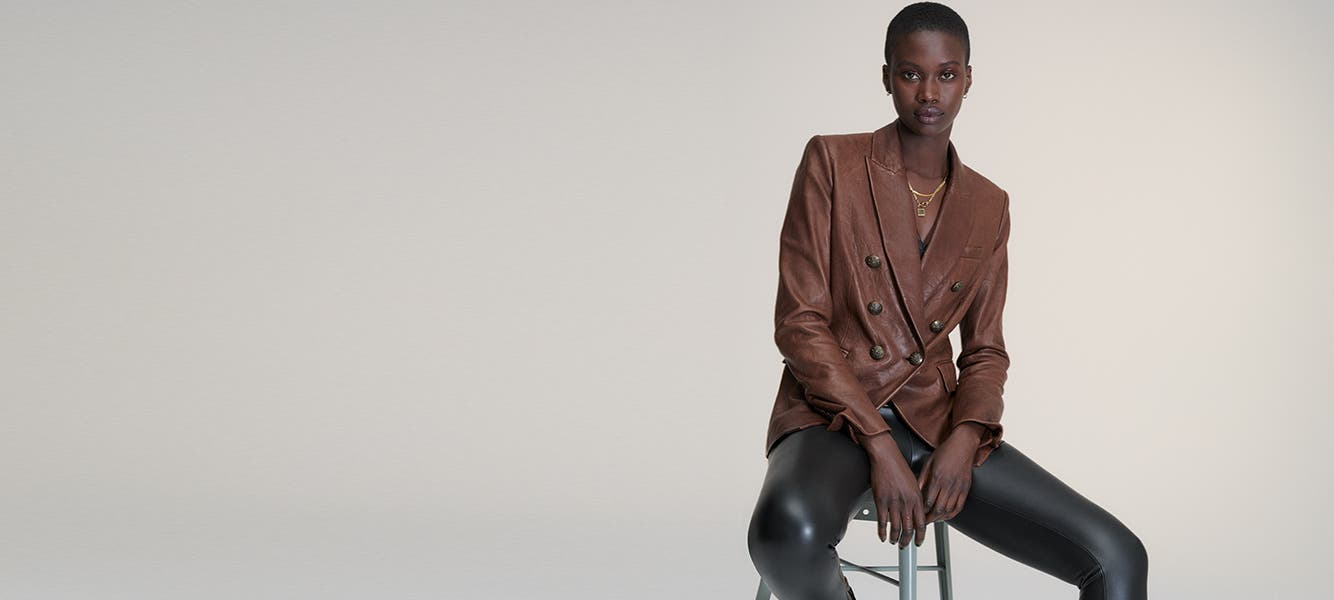 Model wearing faux-leather clothing.