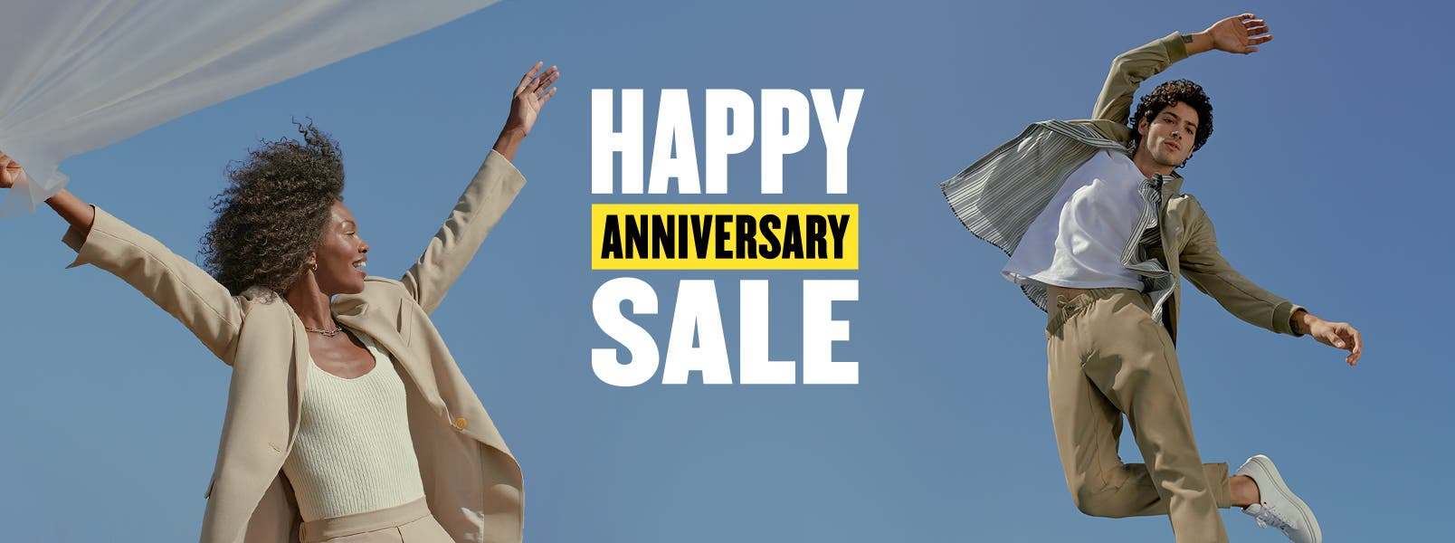 Happy Anniversary Sale. A woman wearing a suit and sweater tank. A man in a jacket, button-up, T-shirt and khakis.