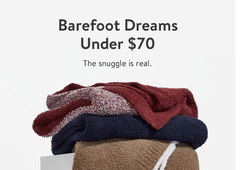 A stack of cozy, multi-colored blankets.