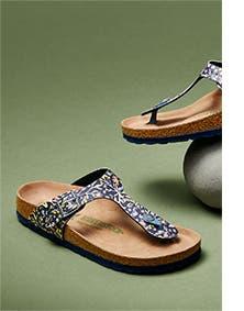 Women's floral-print Birkenstock sandals.
