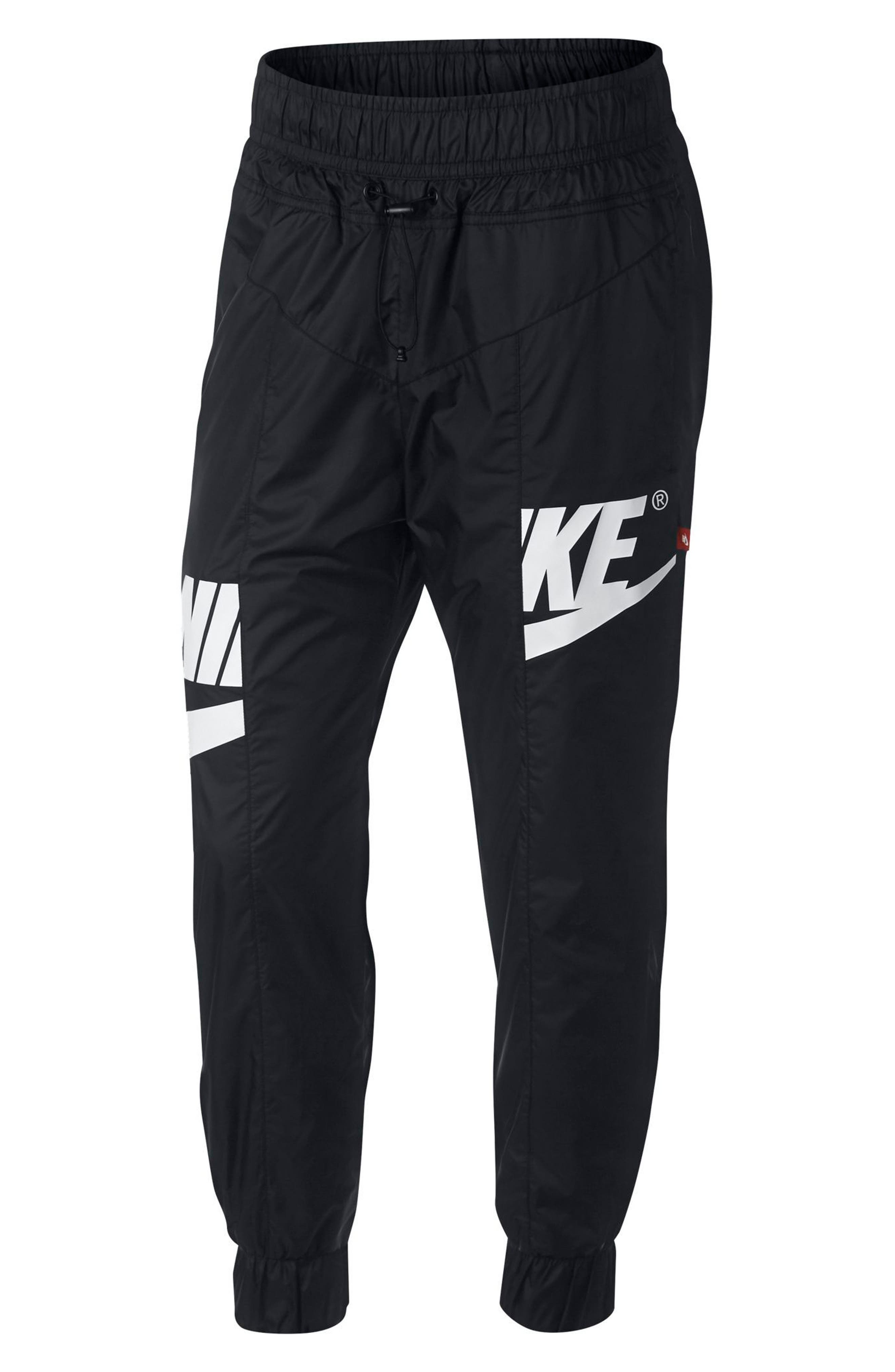 NIKE,                             Sportswear Windrunner Women's Pants,                             Main thumbnail 1, color,                             010