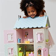 A child with a dollhouse.