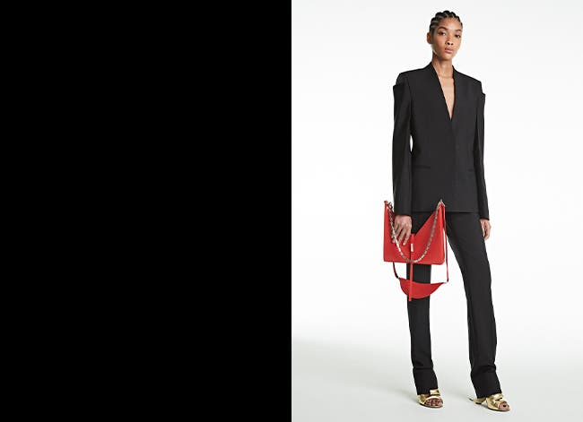 Givenchy Spring/Summer '21 collection: woman wearing black suit and holding red bag.