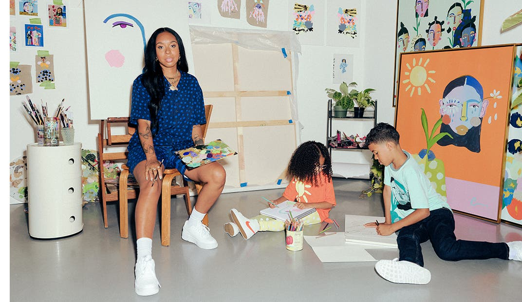 Cristina Martinez sits on a chair as her children play on the floor next to her. Kids model YanYan and Cristina Martinez.