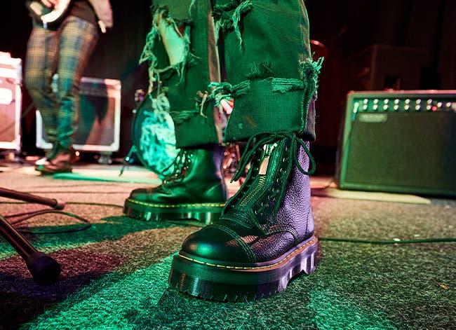 Musicians wearing Dr. Martens boots.