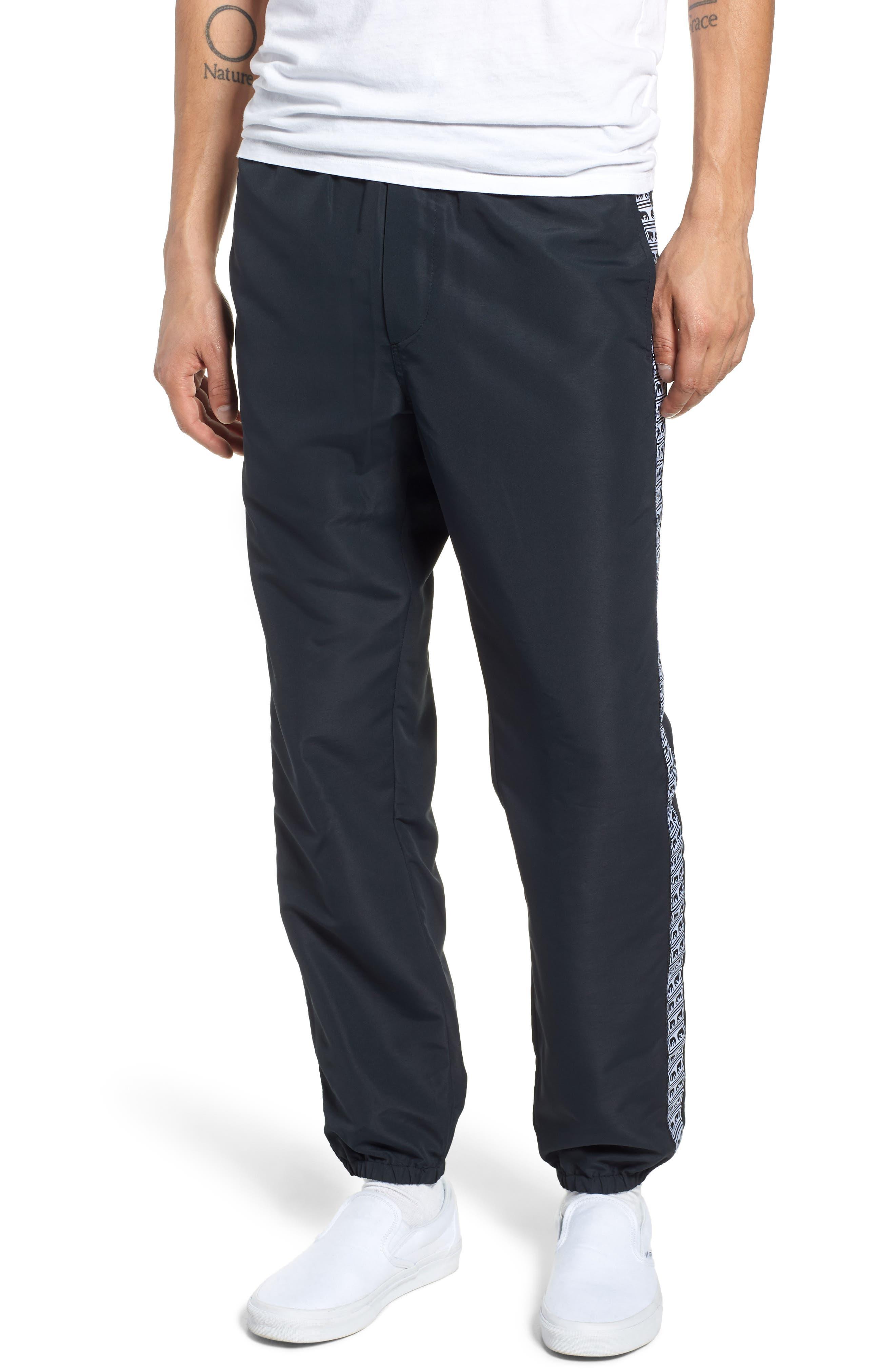 Regular Fit Eyes Taped Track Pants,                             Main thumbnail 1, color,                             BLACK