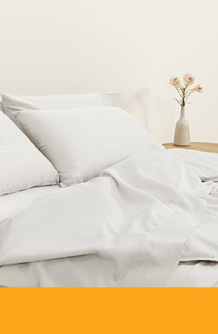 A bed with crisp white bedding.