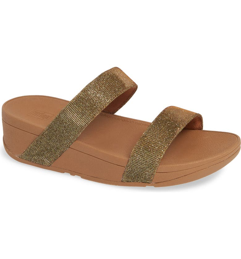 9707a9560034 Two sleek straps shimmer atop a cushy sandal with an arch-supporting  footbed and signature Microwobbleboard midsole for lightweight comfort.