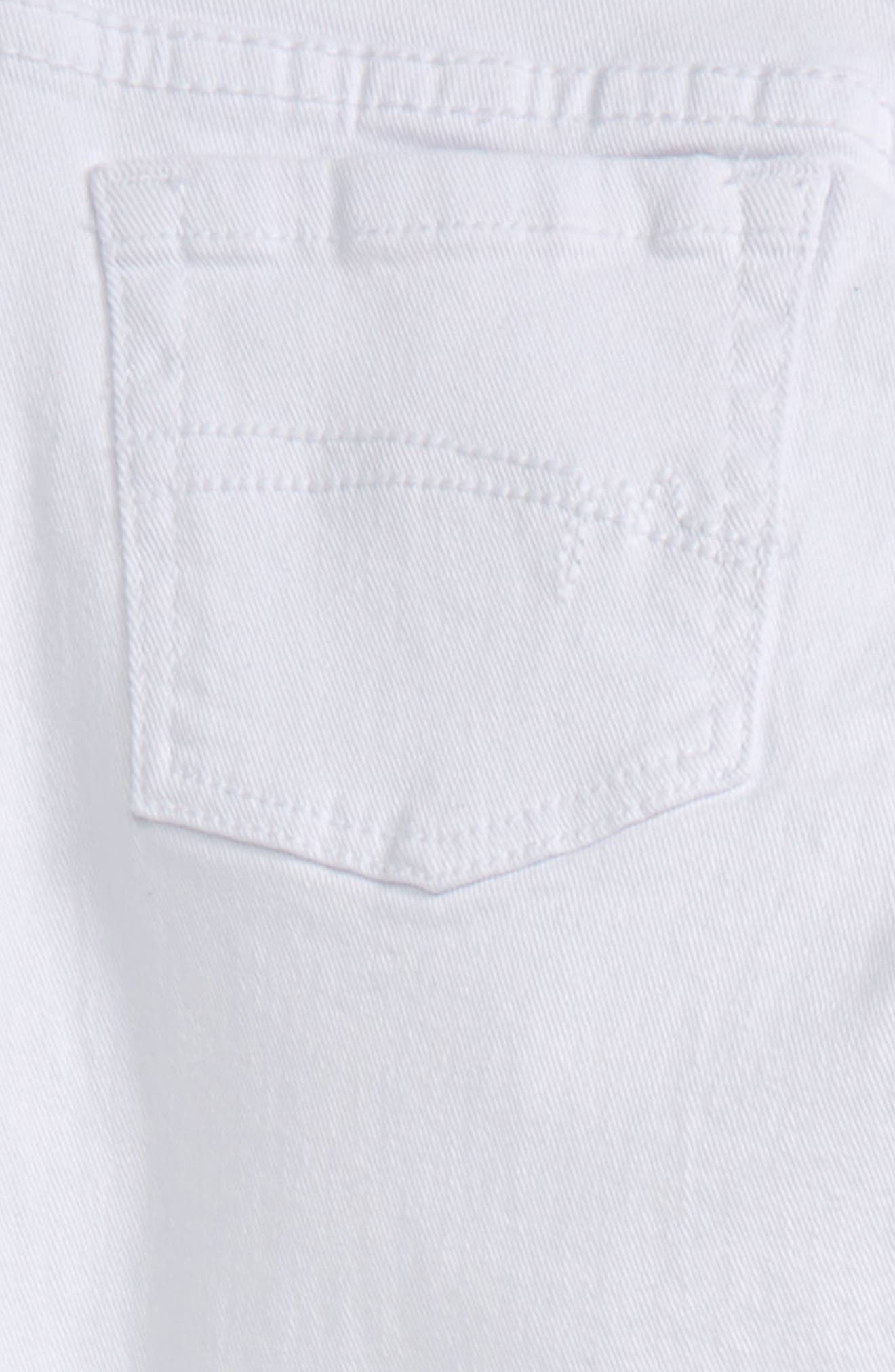 Broderie Anglaise Hem Skinny Jeans,                             Alternate thumbnail 3, color,                             100