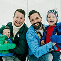 Men and kids in winter clothes.