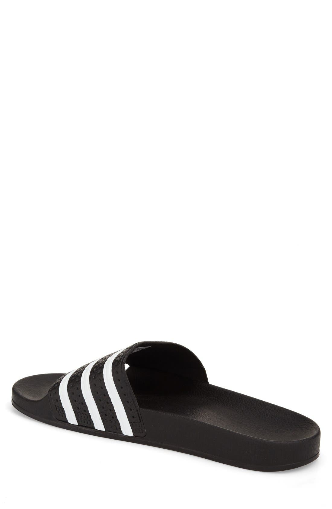 'Adilette' Slide Sandal,                             Alternate thumbnail 4, color,                             BLACK/ WHITE/ BLACK