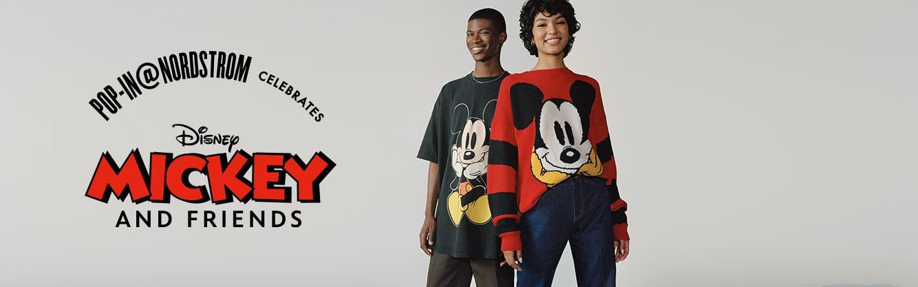 Two models wearing Disney apparel.