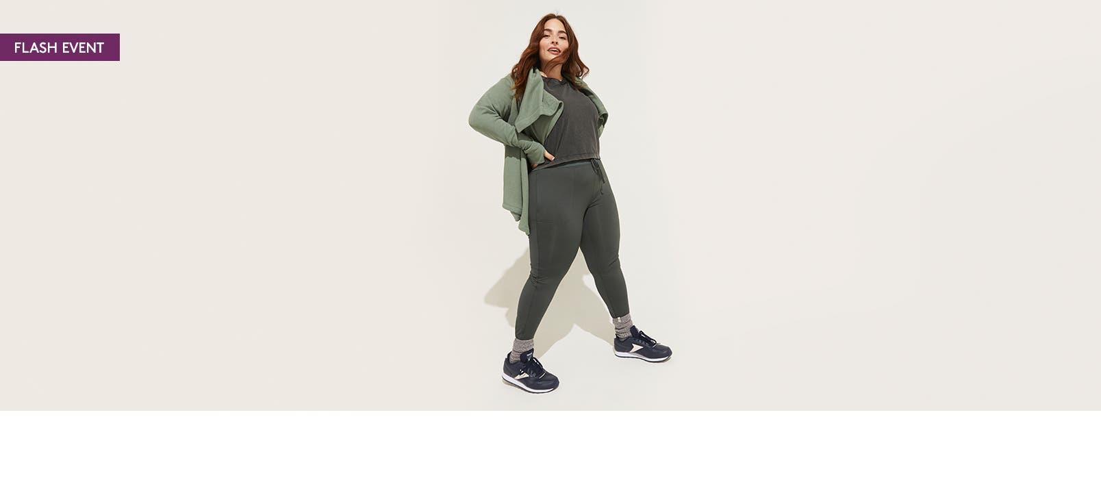 Woman wearing green athletic wear.