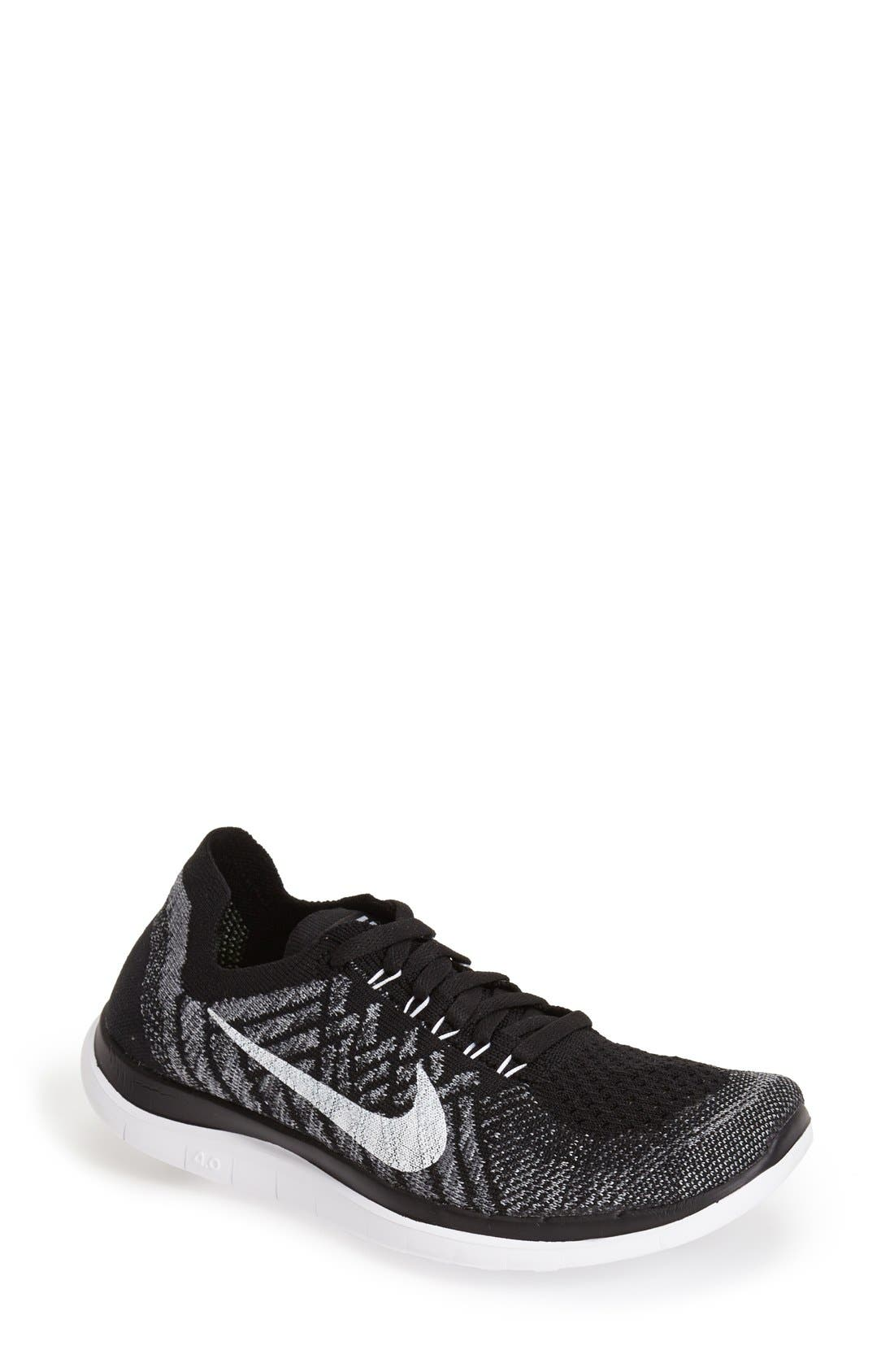'Free 4.0 Flyknit' Running Shoe, Main, color, 001