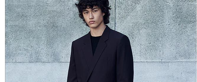 Model wearing designer fall fashion.