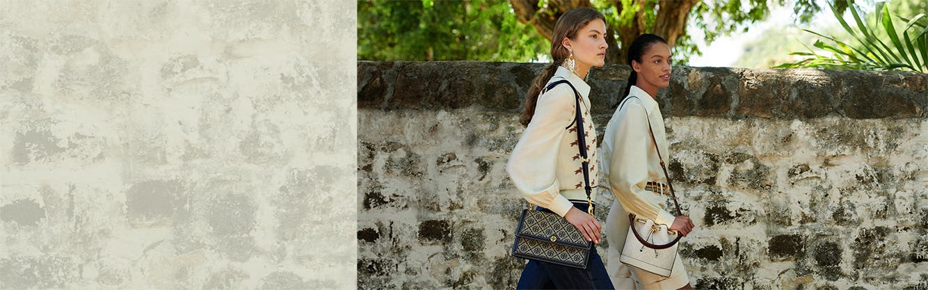 Women walking and wearing Tory Burch clothing and accessories.