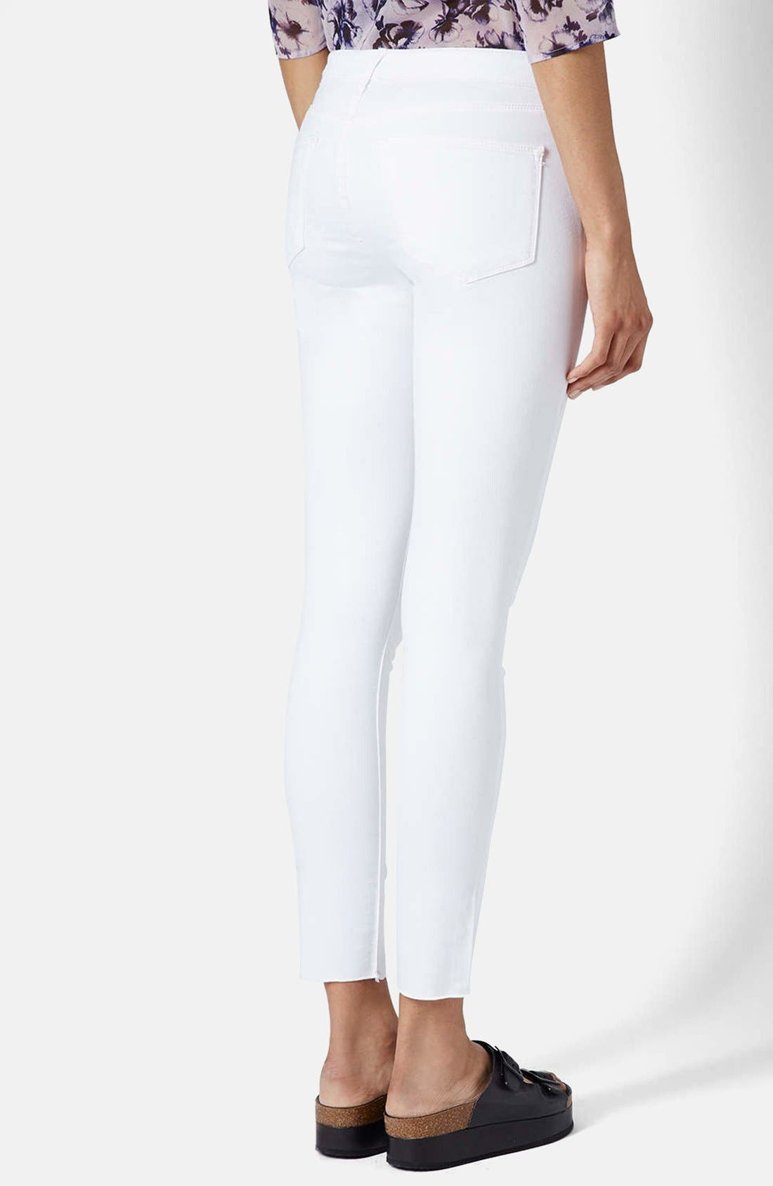 TOPSHOP,                             Moto 'Leigh' Ripped Ankle Skinny Jeans,                             Alternate thumbnail 3, color,                             100
