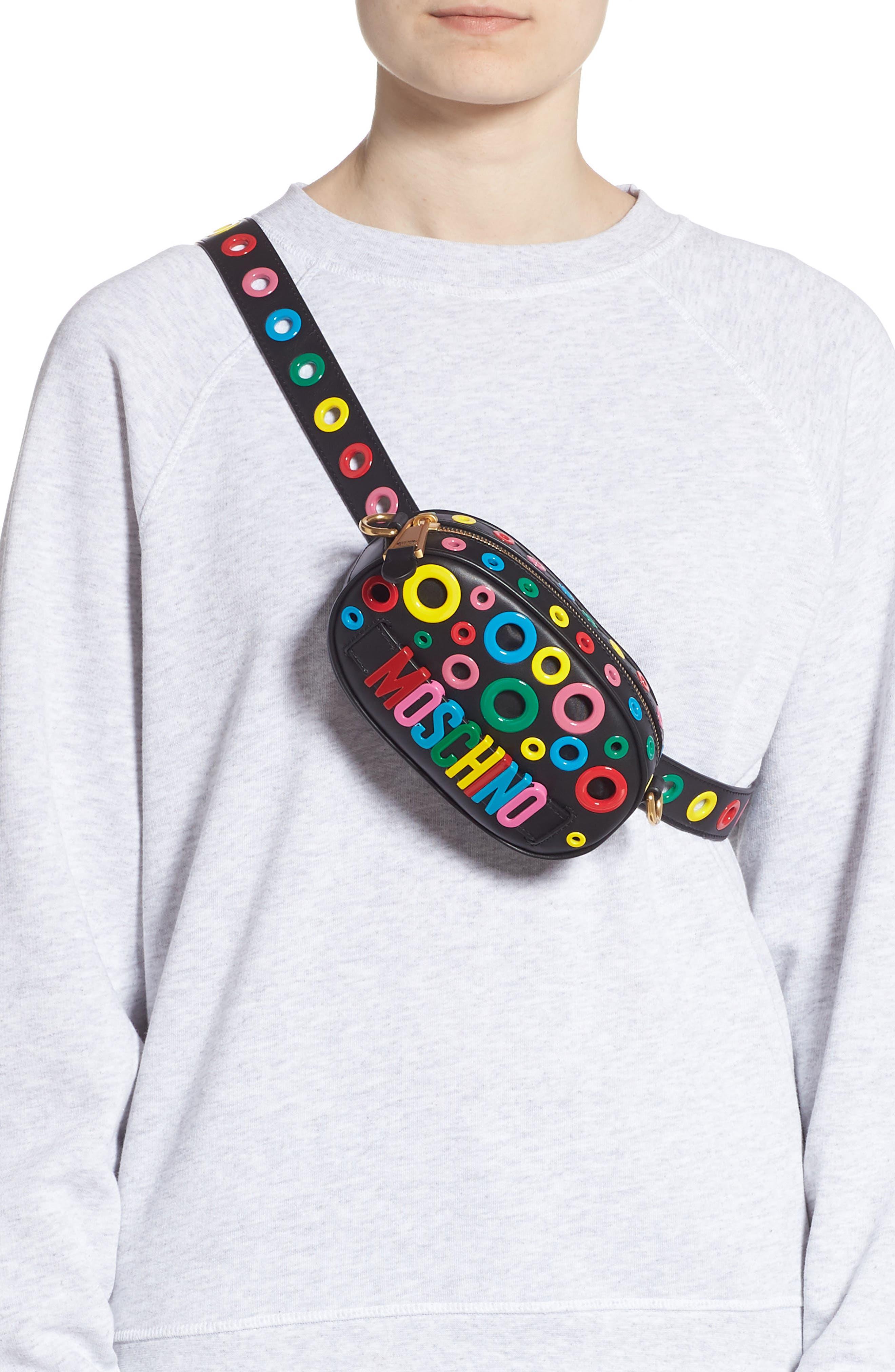MOSCHINO,                             Multi Grommet Belt Bag,                             Alternate thumbnail 4, color,                             BLACK