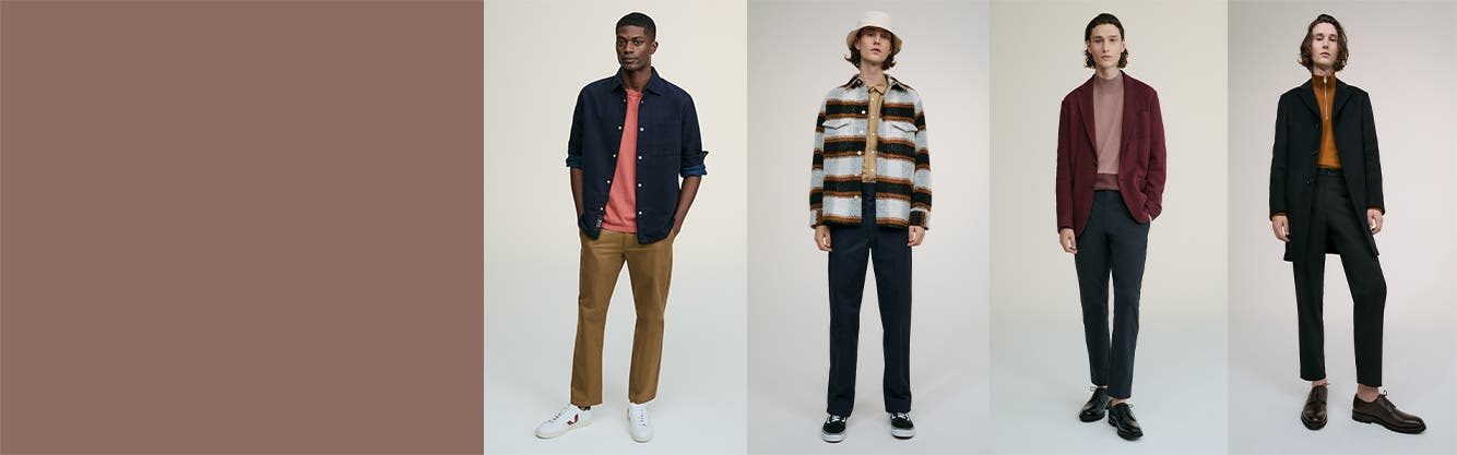 Models wearing men's work clothing, shoes and accessories.